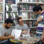 Cesar Alcázar e Fred Rubim autografando